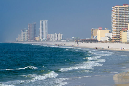 Condos and hotels on the shore of the Gulf of Mexico at Orange Beach, Alabama on a hazy day.