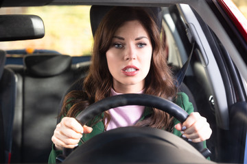 Shocked Woman Driving Car