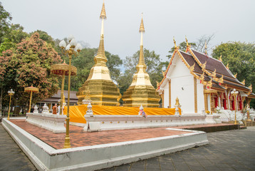Wat Phra That Doi Tung an iconic twin ancient pagoda on Doi Tung mountain of Chiang Rai province of Thailand in winter season.