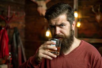 Drunk man. Whiskey, brandy, cognac concept. Drink barman. Pub retro vintage interior. Hipster barman concept. Alcohol addiction.