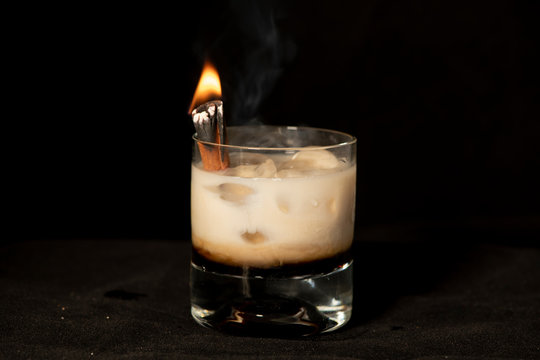 Flaming Cinnamon cocktail with kahlua, baileys irish cream and sambuca