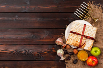 Jewish holiday Passover banner design with wine, matzo on wooden background.