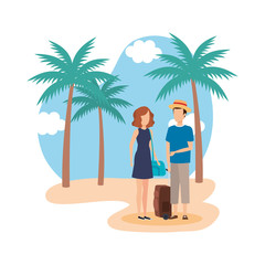 young couple with suitcase on the beach