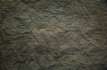 Background or Wallpaper and Detail of dark hardwood floors polished and crumpled like paper in...