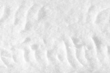 Imprint of the car tire on the snow. A track trace on the road on a winter day.