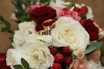 Gold rings on a wedding bouquet