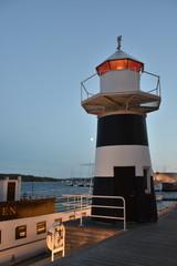 Norwegen, Oslo, Leuchtturm, Licht, Aker Brygge, Stadthafen, Kai, Mole, Licht, Lampe, Leuchtfeuer, Turm, Reling, Geländer, Oslofjord, Fjord, Skandinavien,