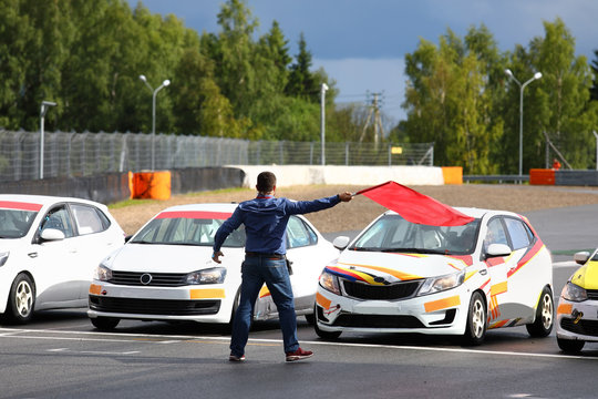 Starter gives the go-ahead red flag to start car racing