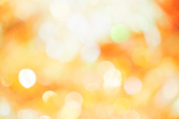 Orange, yellow and white bokeh light. Abstract or blurred of light glitter. Glow texture background.