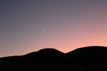 moon and sunset in mountains