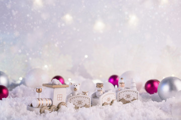 New Year card with toy train on winter background with snow and lights. Template, greeting card