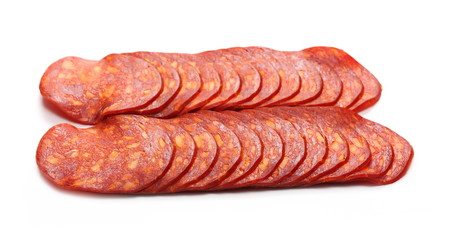 Spicy salami sausage slices isolated on white background