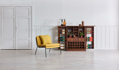 White room yellow chair and old wooden brown open cabinet. home objects.