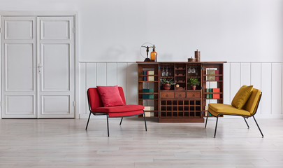 White wall classic background red yellow chair, wooden cabinet retro and book objects.