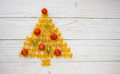 christmas ang new year tree made from pasta and tomatoes on white background free space for text - holidays, winter, celebration,  Christmas and  new year concept
