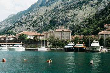 Beautiful view of the Adriatic Sea, mountains, buildings and ships in the Bay of Kotor in Montenegro.