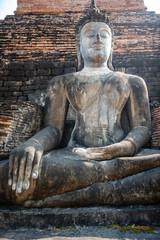 Buddha statue, Thai ancient remains in Wat Mahathat at Sukhothai Historical Park, Thailand