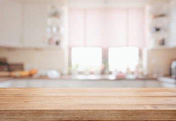 Empty tabletop over defocused kitchen with copy space