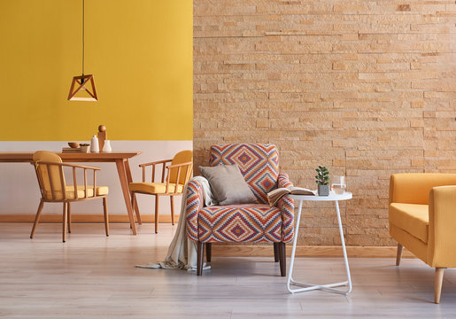 Yellow room wooden furniture and brick wall concept.