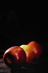 Raw Red apple on dark table