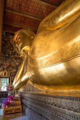 Wat Pho is a Buddhist temple complex in Thailand. The reclining Buddha is a main attraction in Bangkok