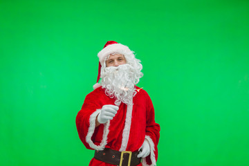 Happy Santa with sparkling fireworks smiles invites you for Christmas party. New Year celebrations concept. Chroma key