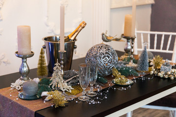 Festive table with Christmas decorations in the home interior