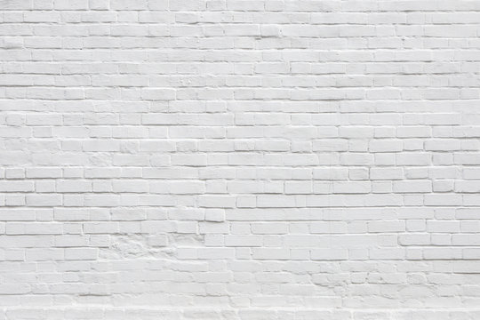 White Rustic Texture. Retro Whitewashed Old Brick Wall Surface. Vintage Structure. Grungy Shabby Uneven Painted Plaster. Whiten Facade Background. Design Element. Abstract Light White Web Banner.