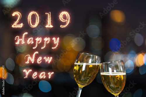happy new year 2019 written with sparkle firework on clinking with two beer mug or glasses