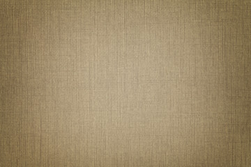 Brown background from a textile material with wicker pattern, closeup.