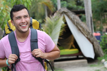Backpacker staying in tropical beach bungalow