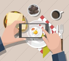 Man taking photos of food on the smartphone. Mobile photography concept.