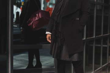 Woman hand in pocket walking in city
