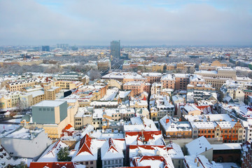 snow-covered bright roofs of a beautiful old winter city