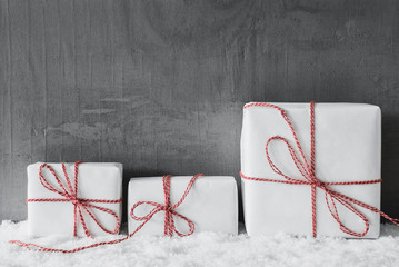 White Gifts With Red Ribbon, Grungy Cement Background, Snow