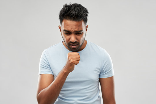 health problem and people concept - unhealthy indian man coughing over grey background