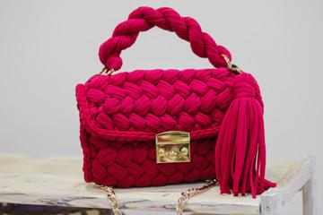 Handmade crochet handbag on white background. Toy knitted handbag