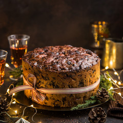 Traditional Christmas fruit cake on dark background