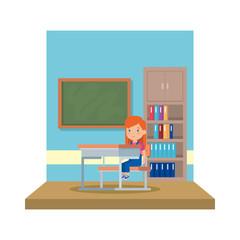 little schoolgirl sitting in schoolchair in the classroom