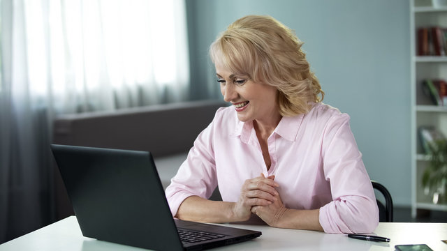 Blond attractive woman chatting with man online, date application, leisure