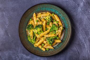 Pasta with broccoli, green peas, garlic, cheese.