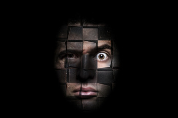 portrait of a man with a puzzled look that decomposes into cubes, concept of robotics