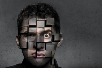 portrait of a man with a puzzled look that breaks down into cubes, the concept of trouble and self-destruction
