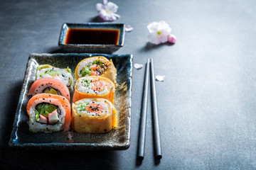 Sushi mix with vegetables and seafood on concrete table