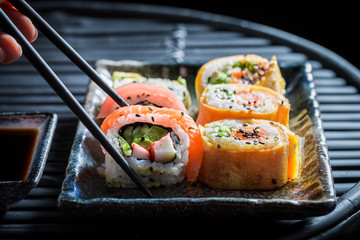Tasting sushi set made of fresh vegetables and seafood