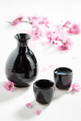 Unfiltered sake with flowers of blooming cherry