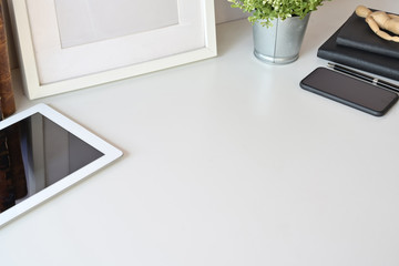 Workspace white top table with office gadget and copy space