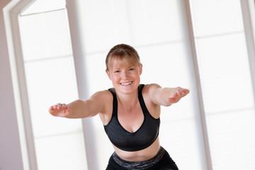 Girl doing squat exercises