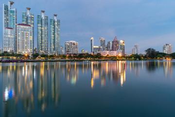 Keuken foto achterwand Kuala Lumpur Night twilight city apartment building with water reflection on lake, cityscape background