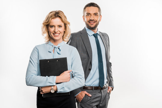 professional business people in formal wear standing together and smiling at camera isolated on white